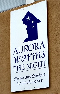 aurorawarmsthenight-sign
